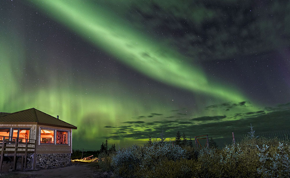 Northern lights over Nanuk Polar Bear Lodge. Charles Glatzer photo
