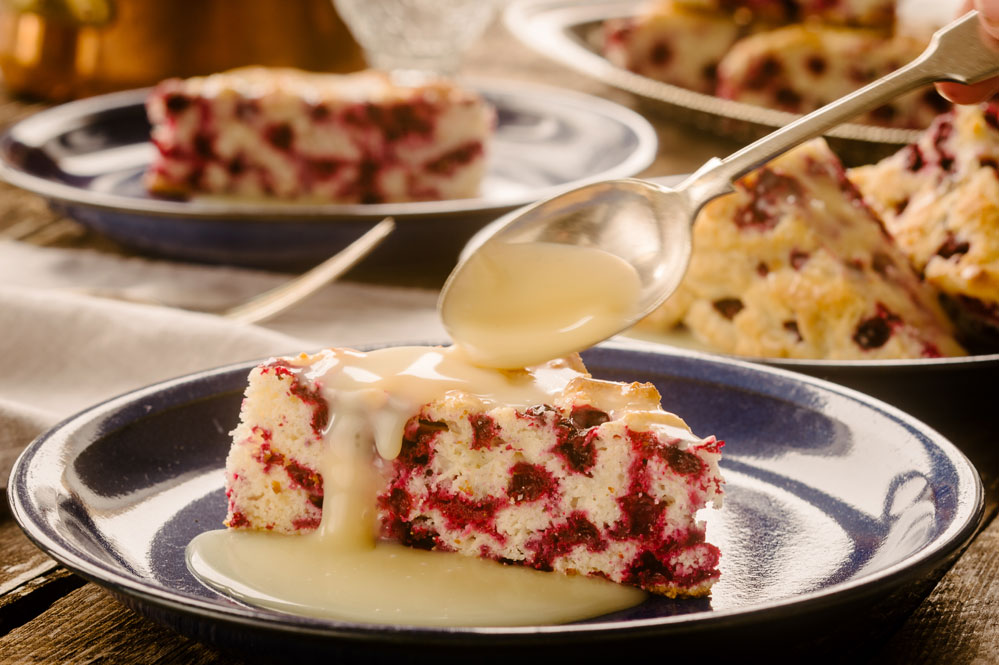 Wild Cranberry Cake with Warm Butter Sauce. A guest favourite!